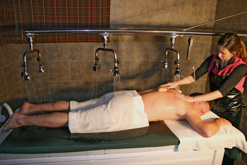 An image of a man receiving a vichy shower massage at the Creekside Spa in June Lake California.