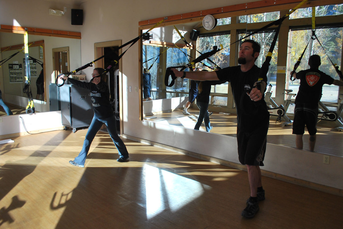 An image of some people working out in the fitness center at the Creekside Spa in June Lake, California