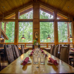 An image of the tables and view out the window at the Eagle's Landing Restaurant in June Lake, California.