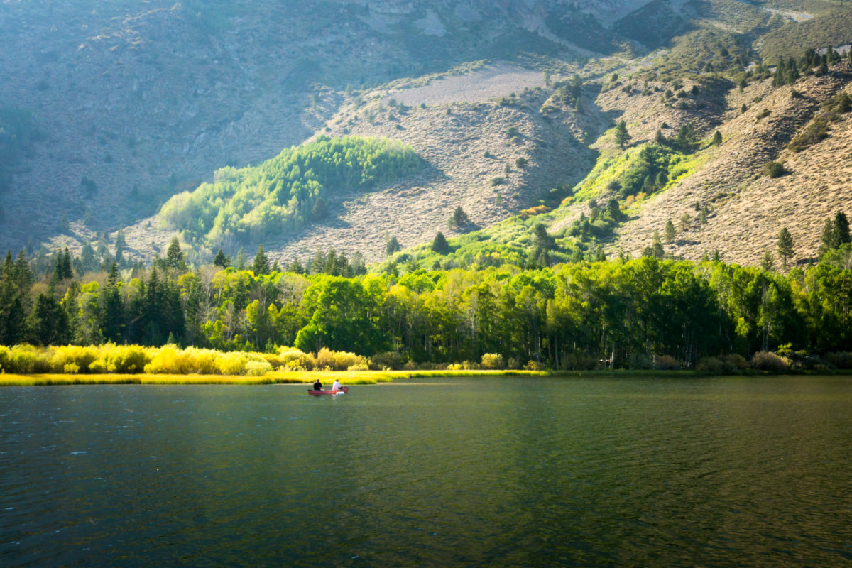 This is an image of fishermen fishing on a small boat on Walker Lake.